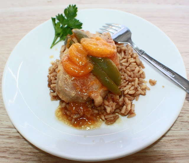 A thickened mandarin orange sauce with boneless pork over rice with peppers Asian Style