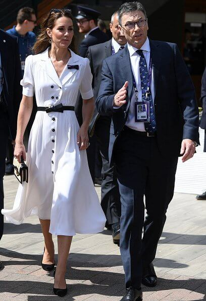 Kate Middleton wore a Suzannah flippy wiggle dress, Alexander McQueen Wicca raffia satchel, Tod's suede pumps
