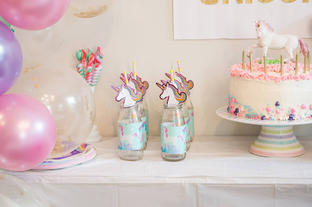 party table at a unicorn birthday party