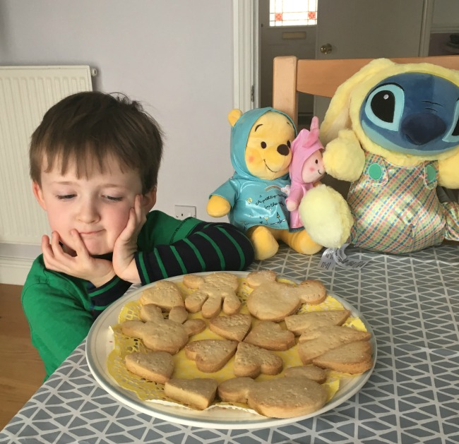 boy-pooh-piglet-and-snitch-soft-toy-looking-at-Disney-cookies-on-a-plate