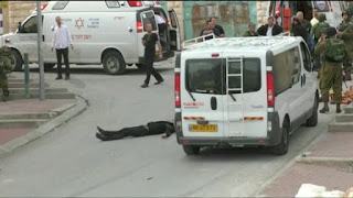 http://www.nydailynews.com/news/world/israeli-soldier-charged-shooting-dead-hurt-palestinian-article-1.2606119