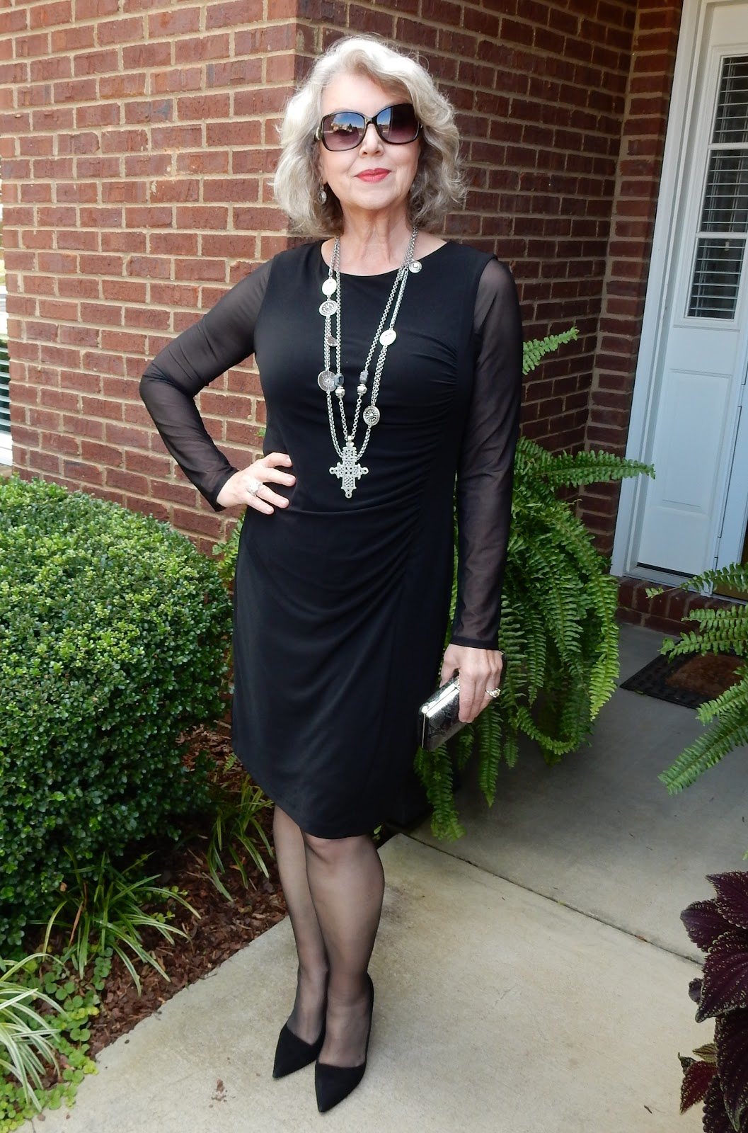 Black dress saying - I Wore A Black Dress From Chico S Last Year The Dress Has Sheer Mesh Sleeves I Paired It With Black Suede Heels From Saks Off 5th And Carried A Small
