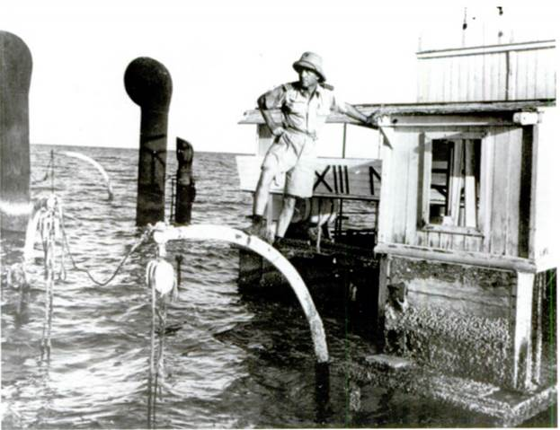 Capt. Edward Ellsberg surveying the harbor of Massowa from a sunken wreck