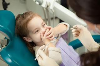 صور اطفال عند طبيب اسنان