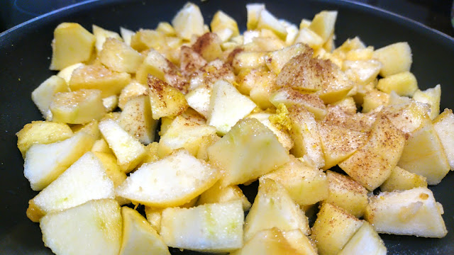 cubed apples in a pan with cinnamon