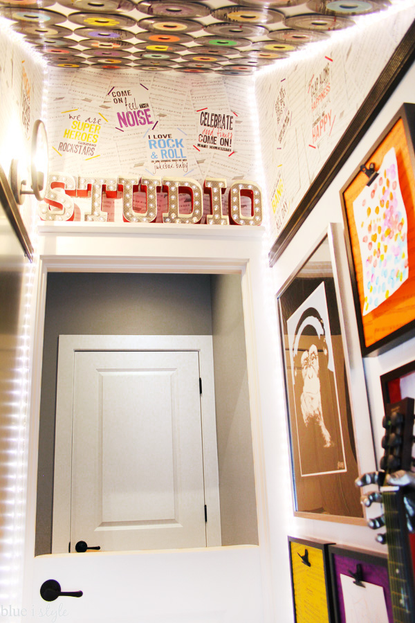 A kids' music studio under the basement stairs. This mini-playroom is packed with music and fun, including the DIY sheet music wall paper on the upper part of the walls.