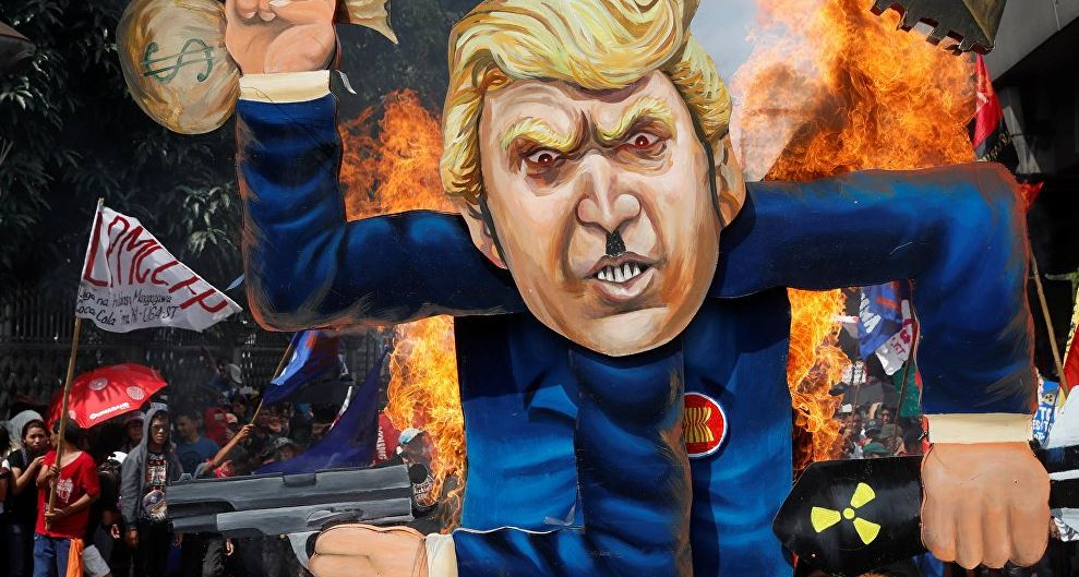 Militant groups burn the effigy of U.S. President Donald Trump