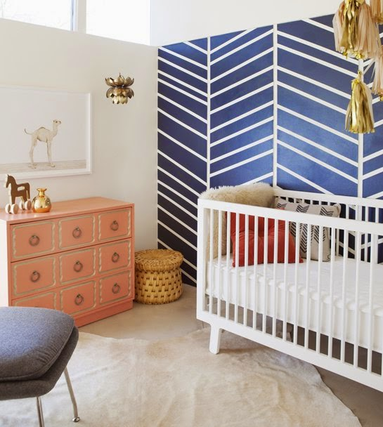 nursery in navy and coral  and tassel garland