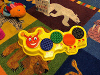 Musical caterpillar toy with built-in capability switches