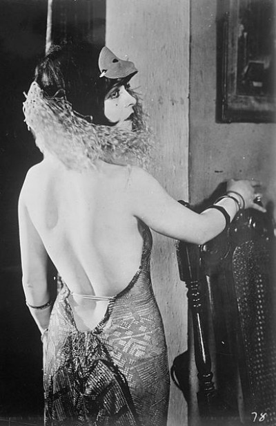 "Clara Bow in back view of halter dress for 1925 film ""My Lady of Whims"""