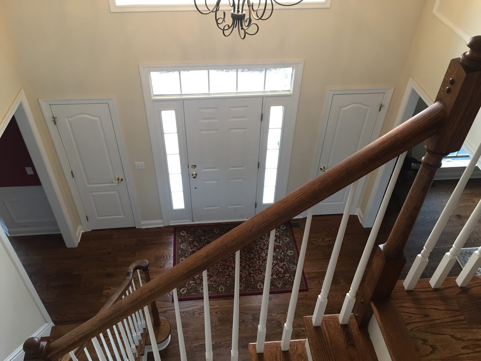Foyer After with Hardwood Floors and new staircase