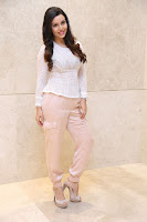 Kyra Dutt in Tight White Top Trousers at Paisa Vasool audio success meet ~  Exclusive Celebrities Galleries 039.JPG