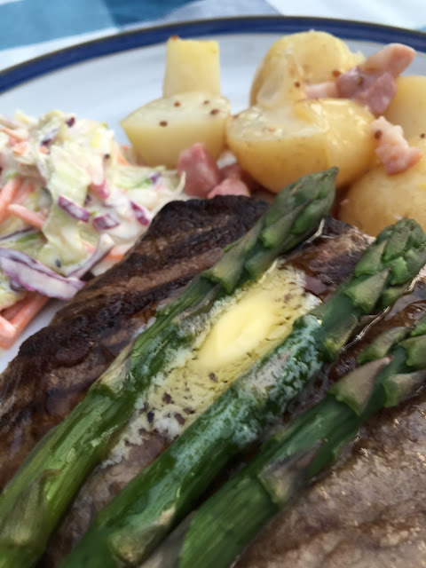 steak, coleslaw and buttered asparagus