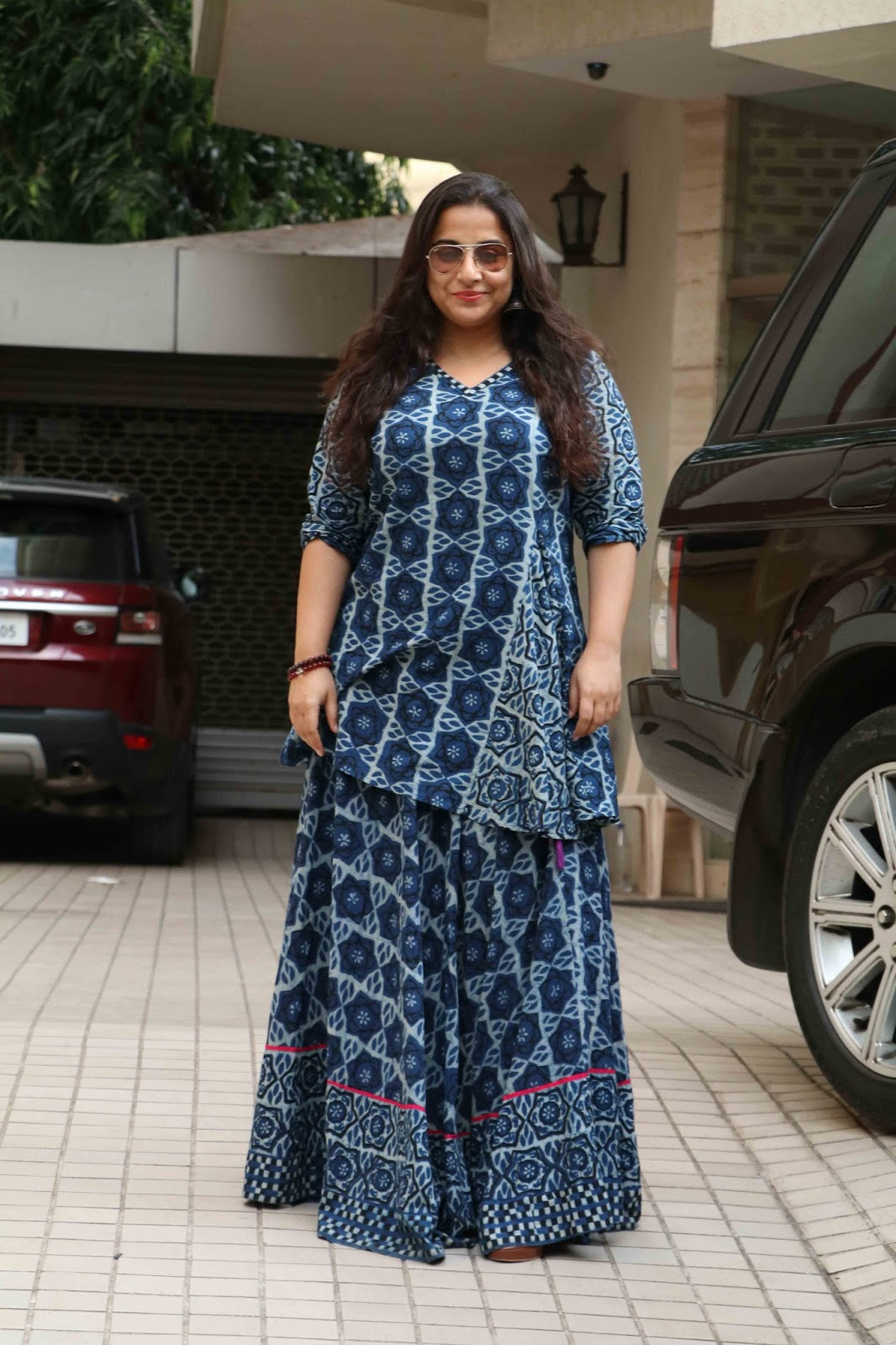 Beautiful Hindi Actress Vidya Balan  With glass Long Hair Photos In Blue Dress
