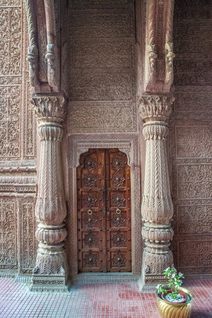 Beautiful carvings on the stone and door.