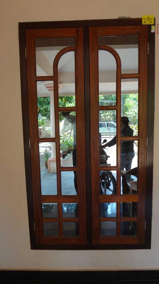 Bavas Wood Works Pooja Room Door Frame And Door Designs: Latest Kerala Model Wooden Window Door Designs