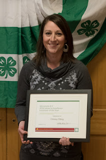 Minnesota 4-H volunteer of the year Crissy Otting holding award