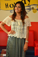 Eesha in a cute deep neck top and Skirt at at Big FM 079.JPG