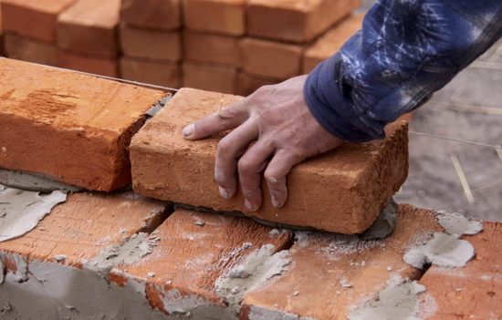 Image of bricklaying by Torange.biz and released under Creative Commons 4.0 International.