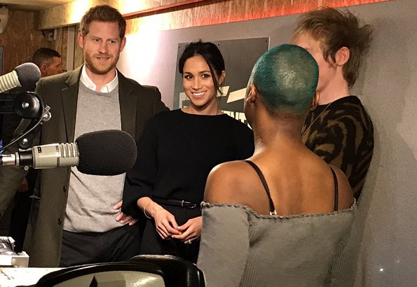 Prince Harry and Meghan Markle visited Reprezent 107.3FM. Meghan is wearing a coat by Smythe, Marks & Spencer sweater and Burberry trousers