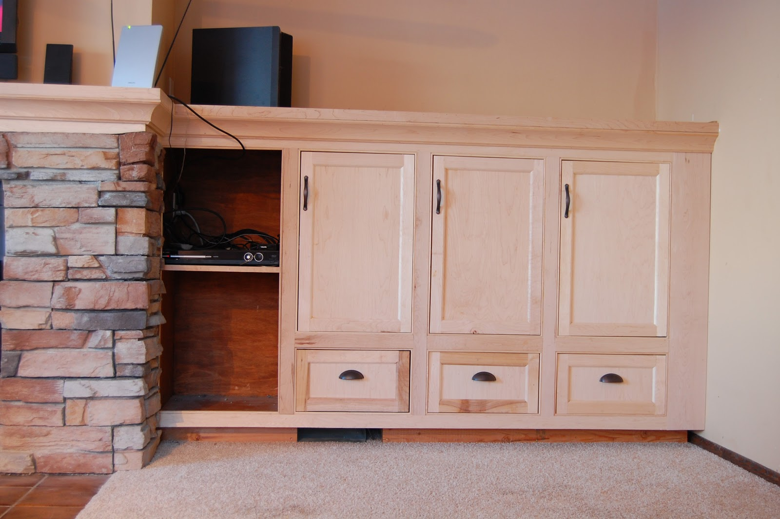 Remodelaholic   Amazing DIY Fireplace and Built-Ins
