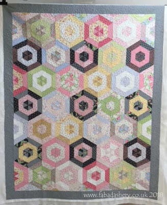 Jelly Roll Hexagon Quilt made by Ruth,  quilted by Frances Meredith