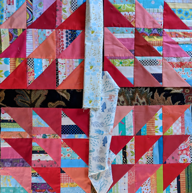 Comparing two white prints as the central cross in The Square Deal quilt block.