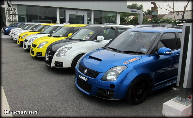Previous gen Suzuki Swift Car Club owners proudly showing off their ride
