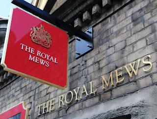 Sign outside Royal Mews at Buckingham Palace, London