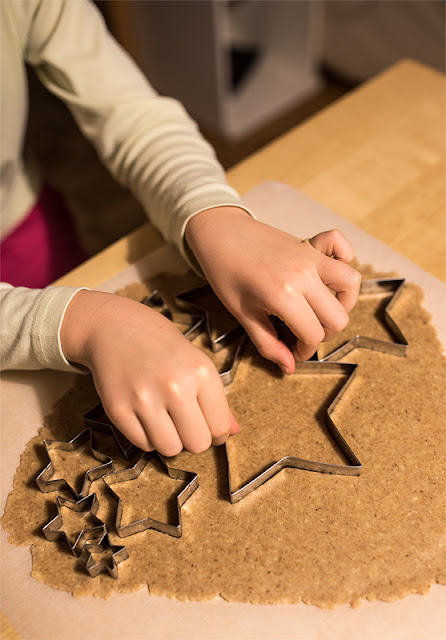 cutting stars from cookie dough