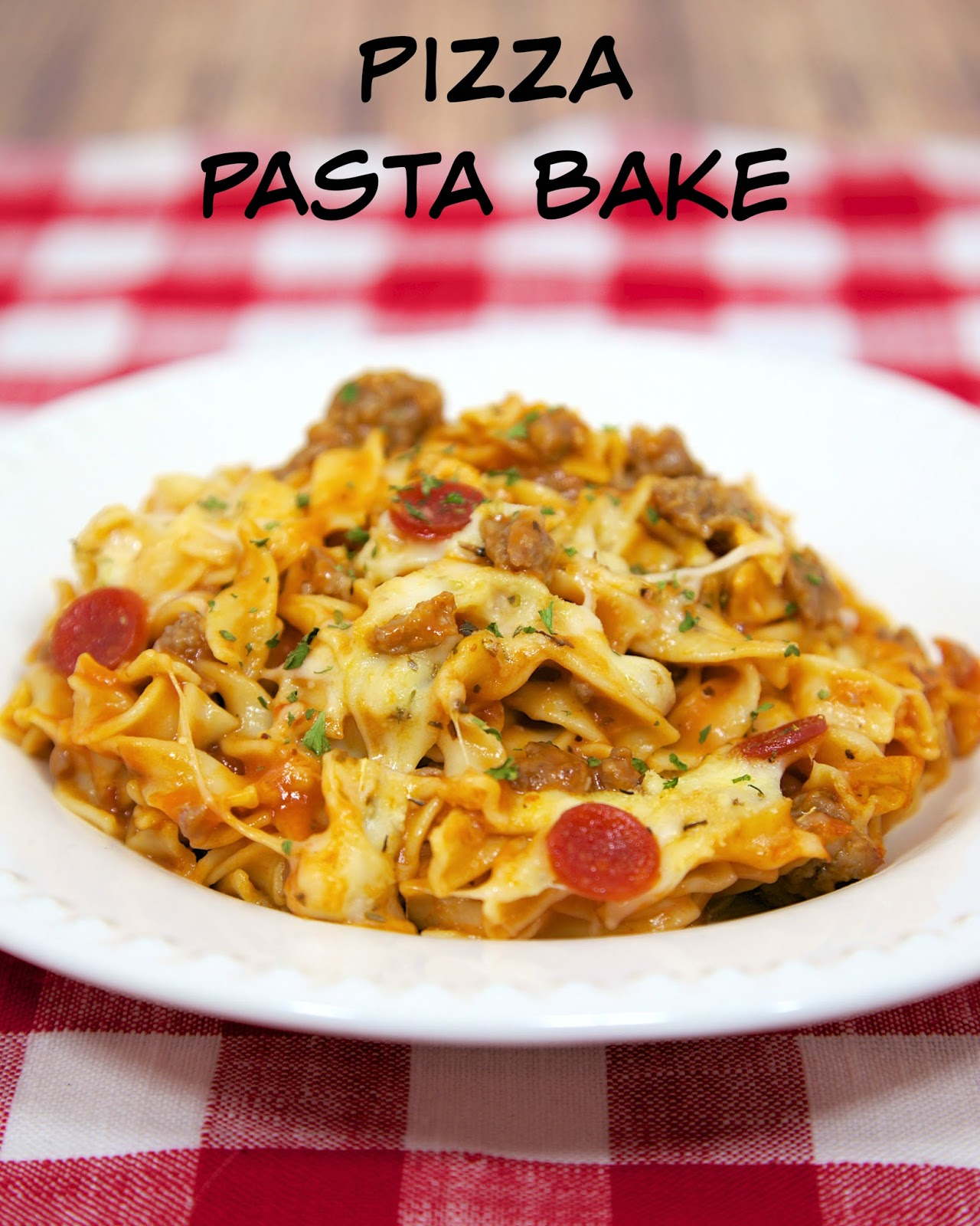 Pizza Pasta Bake - cheesy pasta bake with pizza sauce and your favorite pizza toppings! Hamburger or sausage, egg noodles, cheese soup, mozzarella cheese, parmesan cheese and pepperoni. Great weeknight meal! Kid-friendly and a good freezer meal! We love this easy pasta casserole recipe!