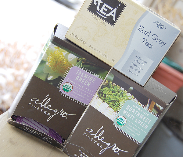 a box of earl grey tea, a box of allegro jasmine tea and a box of allegro northwest minty green tea