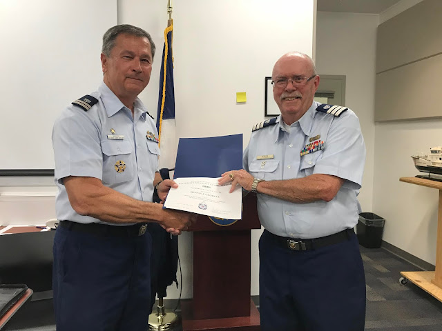 Auxiliarist Dennis Georgia received his Membership Service Award for 20 years of service from FC Bill Iwanyk during the May Business Meeting.