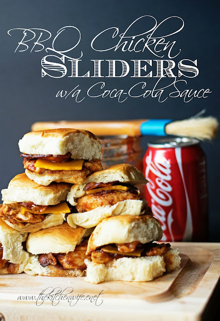 A stack of the BBQ chicken sliders, on a wood cutting board, with the bbq sauce and a can of Coke behind it and the title above.