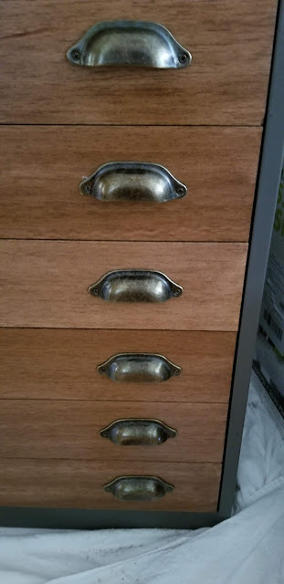 wood slats and vintage hardware added to file cabinet drawers