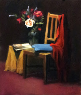 Oil painting of a vase of flowers on a table with an open magazine and beside a chair with a blue cushion draped with a red cloth.