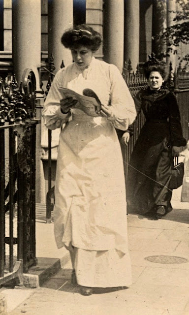 Vintage photo. Edwardian era lady reads a paper as she walks home. Deadly Dullness, A Word to Women by Mrs. C. E. Humphry, 1898. marchmatron.com