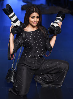 WOW Shriya Saran looks Amazing in Black Top and Tropusers with Camera in Hand at Lakme Fashion Week 2017