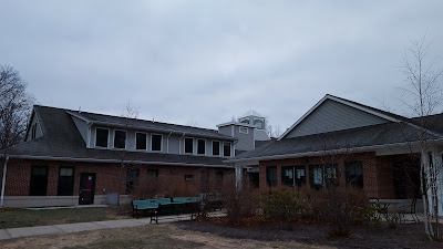 The back side of the Senior Center shows the rise in the roof where the elevator shaft is located