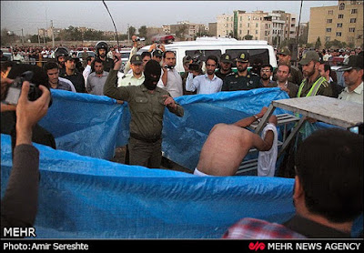Medieval: An inmate is publicly flogged prior ho his execution by hanging in Iran