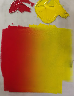 red yellow ink rainbow roll relief printmaking
