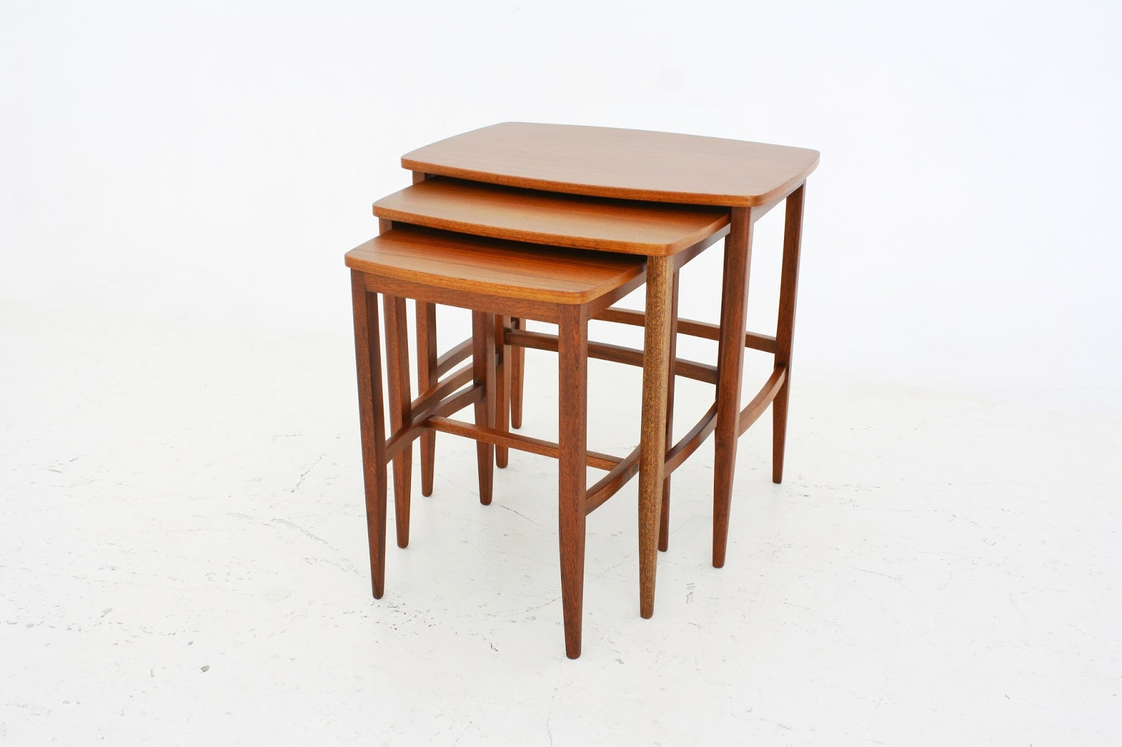 VAMP FURNITURE: A mid-century nest of tables in Sapele and