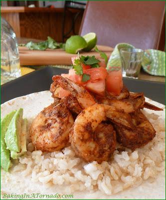 Taco Shrimp, full of Tex-Mex flavors, shrimp is rubbed, pan sautéed and served with Pico de Gallo and avocado slices | Recipe developed by www.BakingInATornado.com |#recipe #shrimp #dinner
