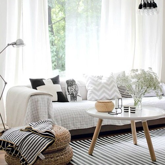 The unique patterns and pieces of Bohemian and modern styles come together to create a comfortable and stylish living room.  {Little House of Four}