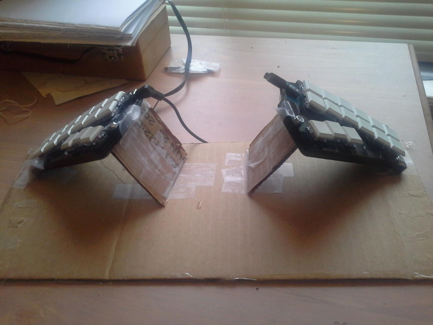 a Georgi on a desk tented using cardboard and tape