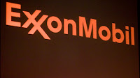Company banner during an ExxonMobil annual shareholder meeting. (Credit: Brian Harkin/Getty Images) Click to Enlarge.