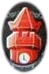 The top of an orangish-red clock tokwer, with a stylized rood that looks like a pointed crown.