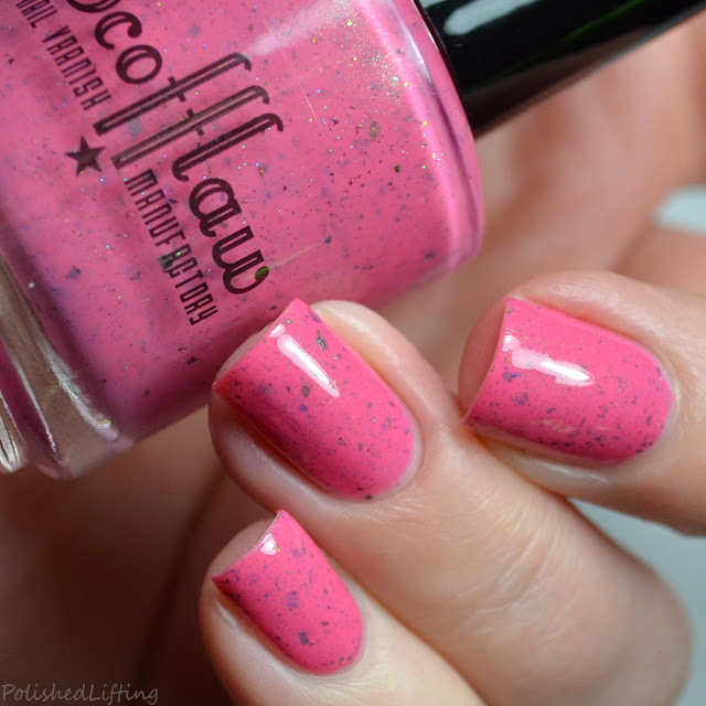 pink nail polish with flakies