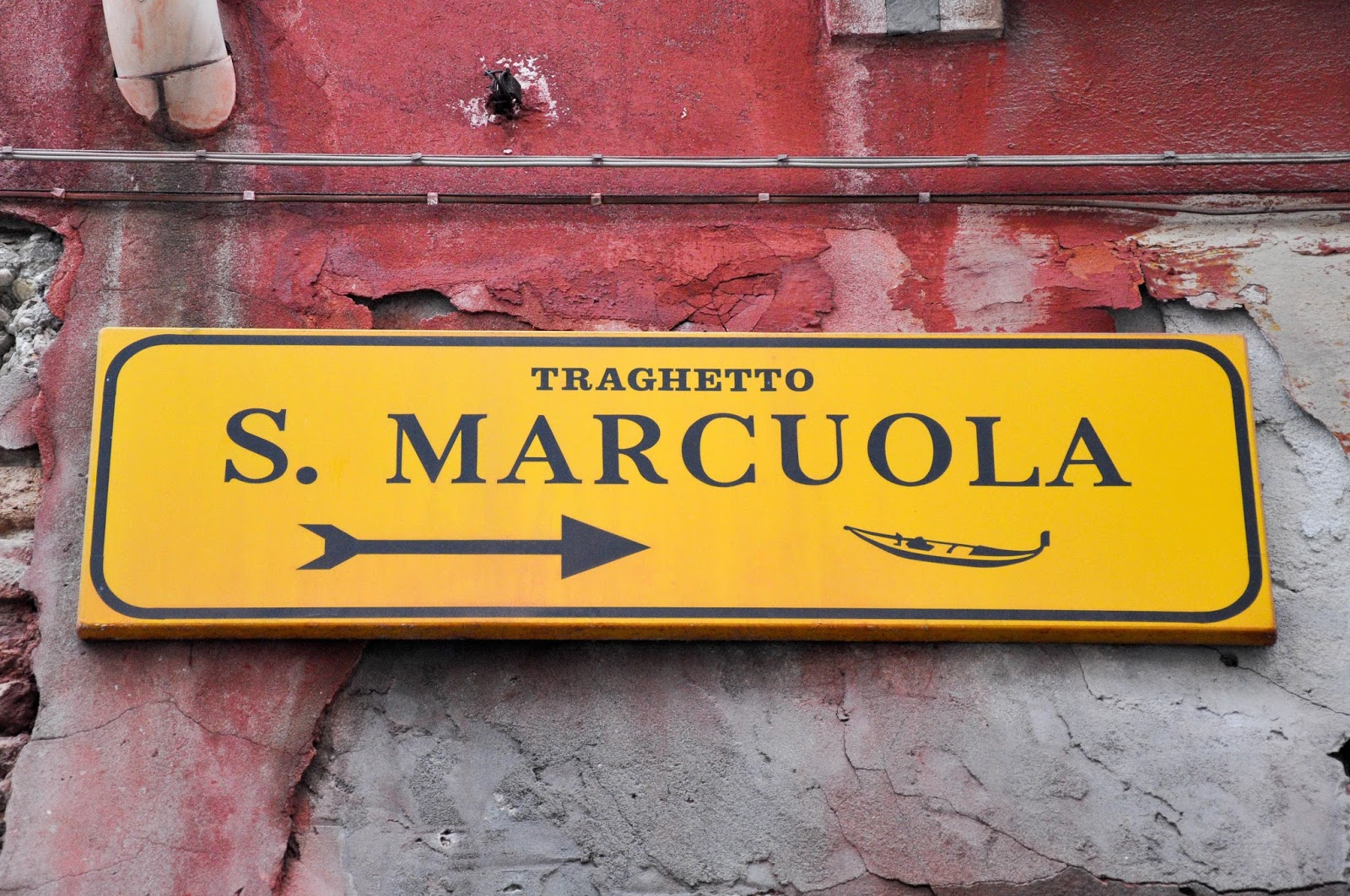 Sign pointing to S. Marcuola traghetto stop, Venice, Italy