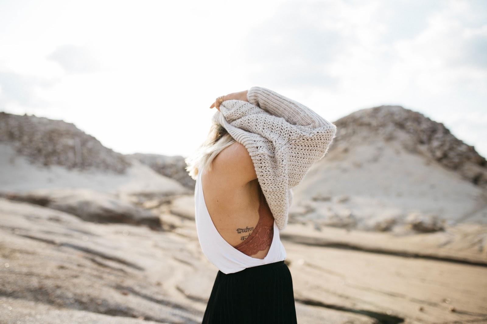 women taking off knitted sweater blog da mo